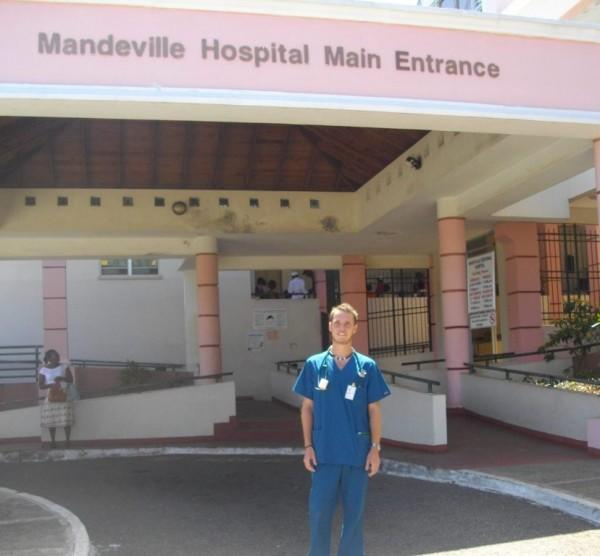 Male Medical intern stands outside Mandeville Hospital in Jamaica during his Medicine Internship.